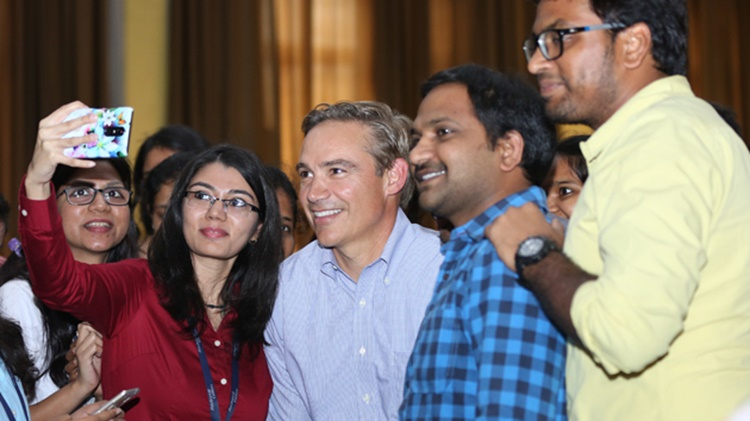 Kelly Ortberg takes photo with employees during Town Hall event