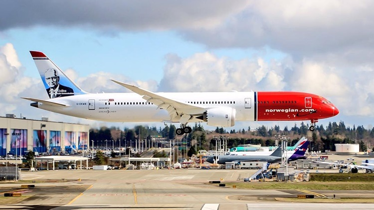"""Arthur Collins, the founder of Rockwell Collins, will be featured as a """"tailfin hero"""" on Norwegian Air's Boeing 737 MAX and 787 Dreamliner aircraft throughout 2018."""