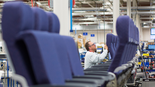 An employee from Rockwell Collins' new Interior Systems business building airline cabin seats at its Winston-Salem, North Carolina-based facility.