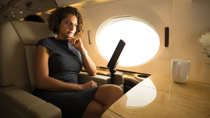 Woman watching device from luxury cabin