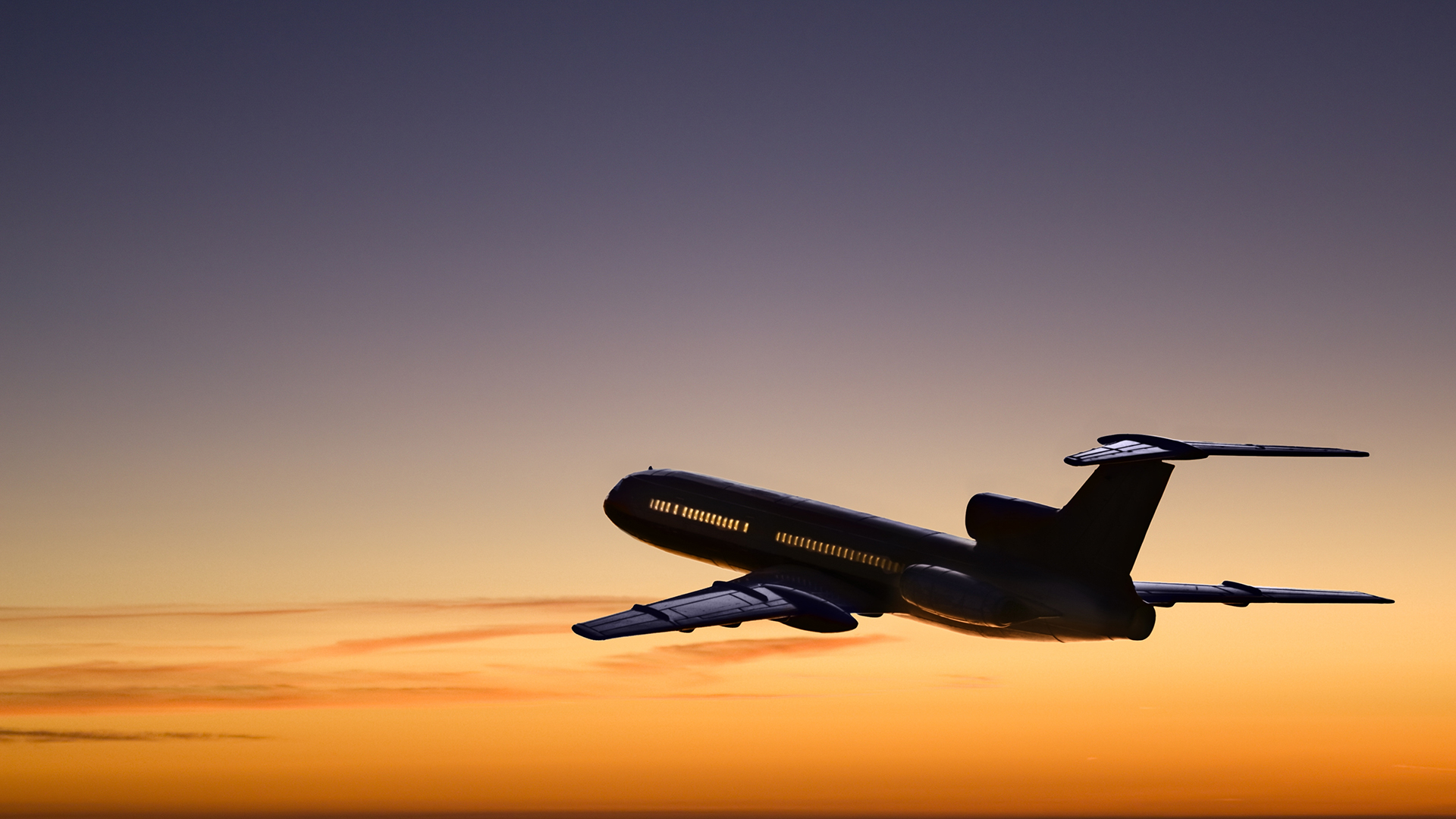 Passenger airplane flying at sunset