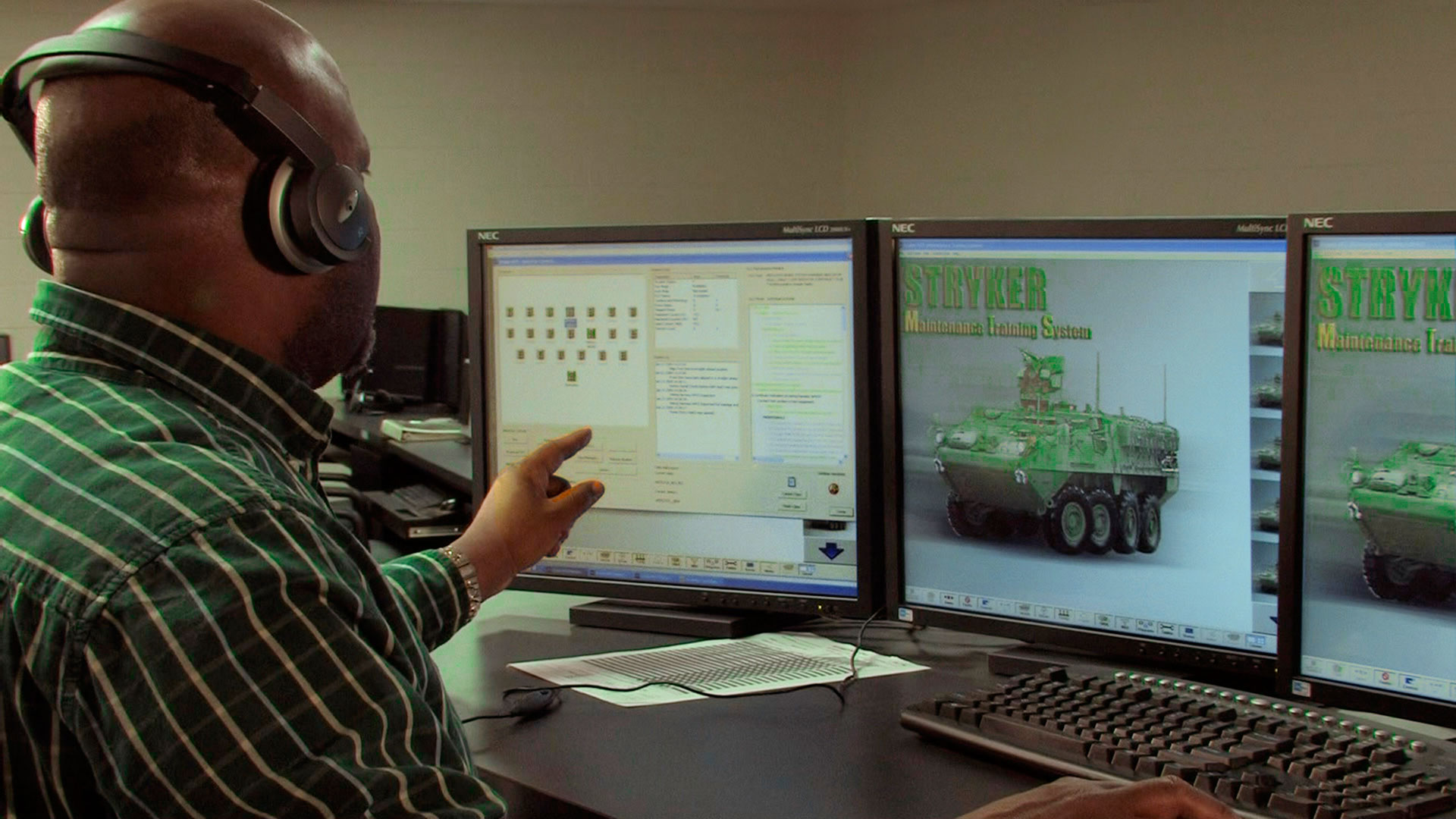 Man looking at computer with Stryker training