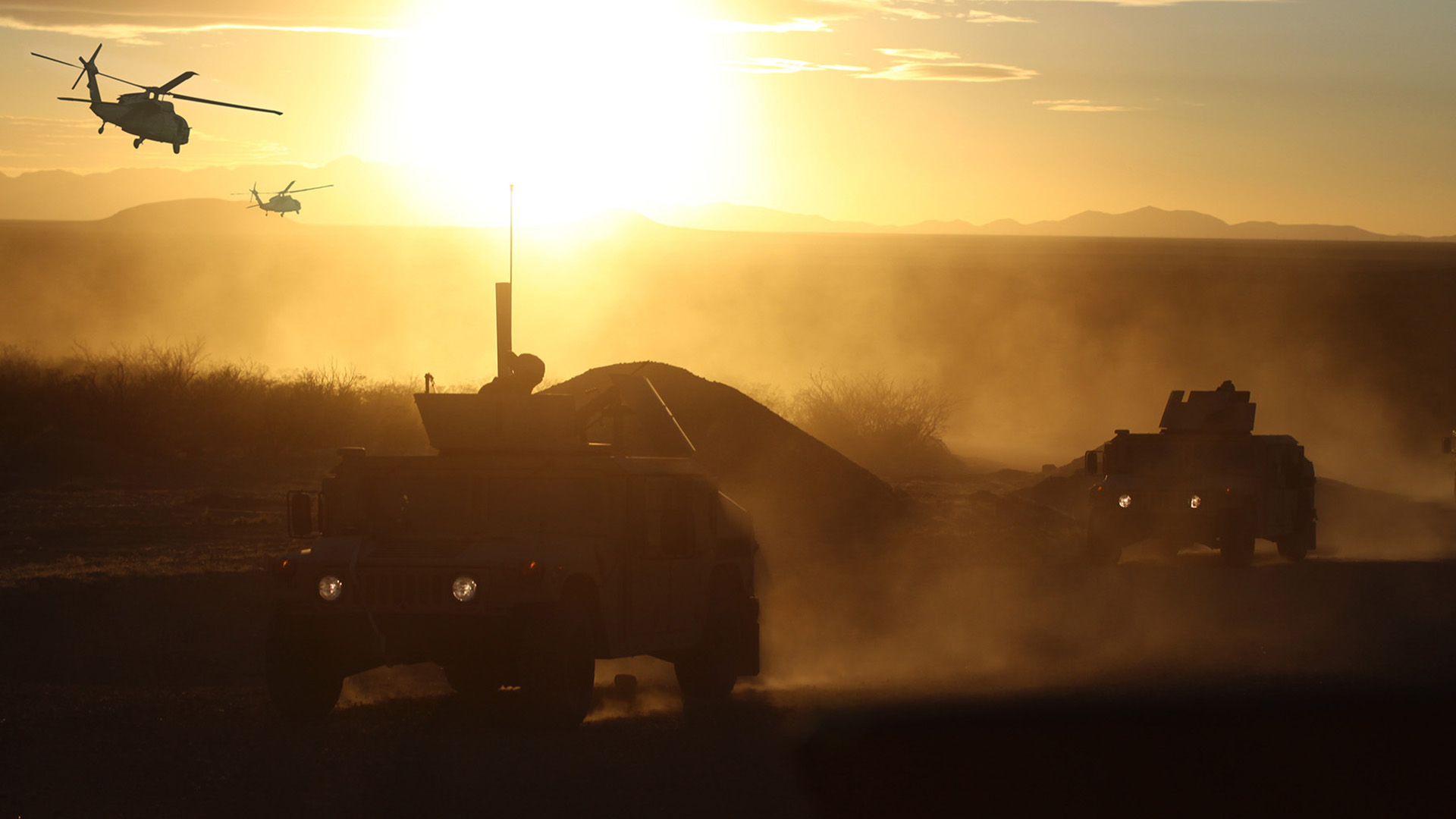 Scenic image with Humvee and helicopter