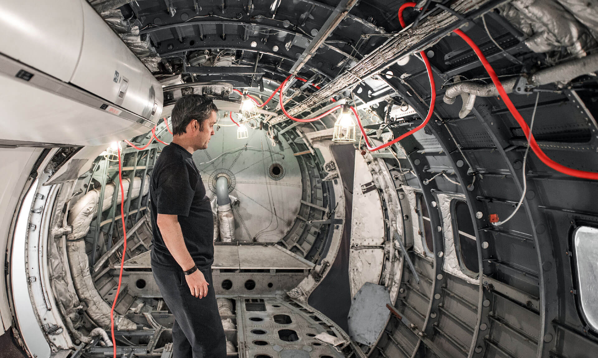 Man inside cargo area of an airplane