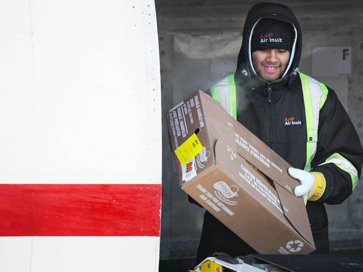 Man carrying package for delivery