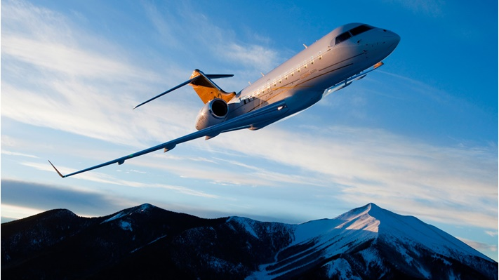 Bombardier Global 5000 flying above mountains