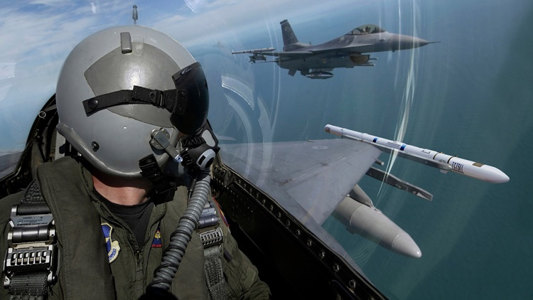 fighter pilot mask and fighter jet flying in formation