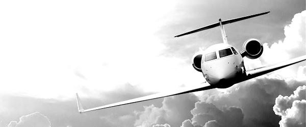 black and white airplane flying in sky
