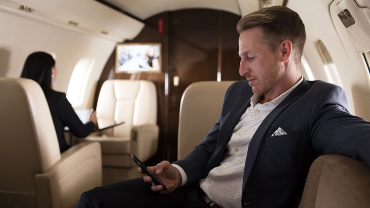 Man using wifi on business jet
