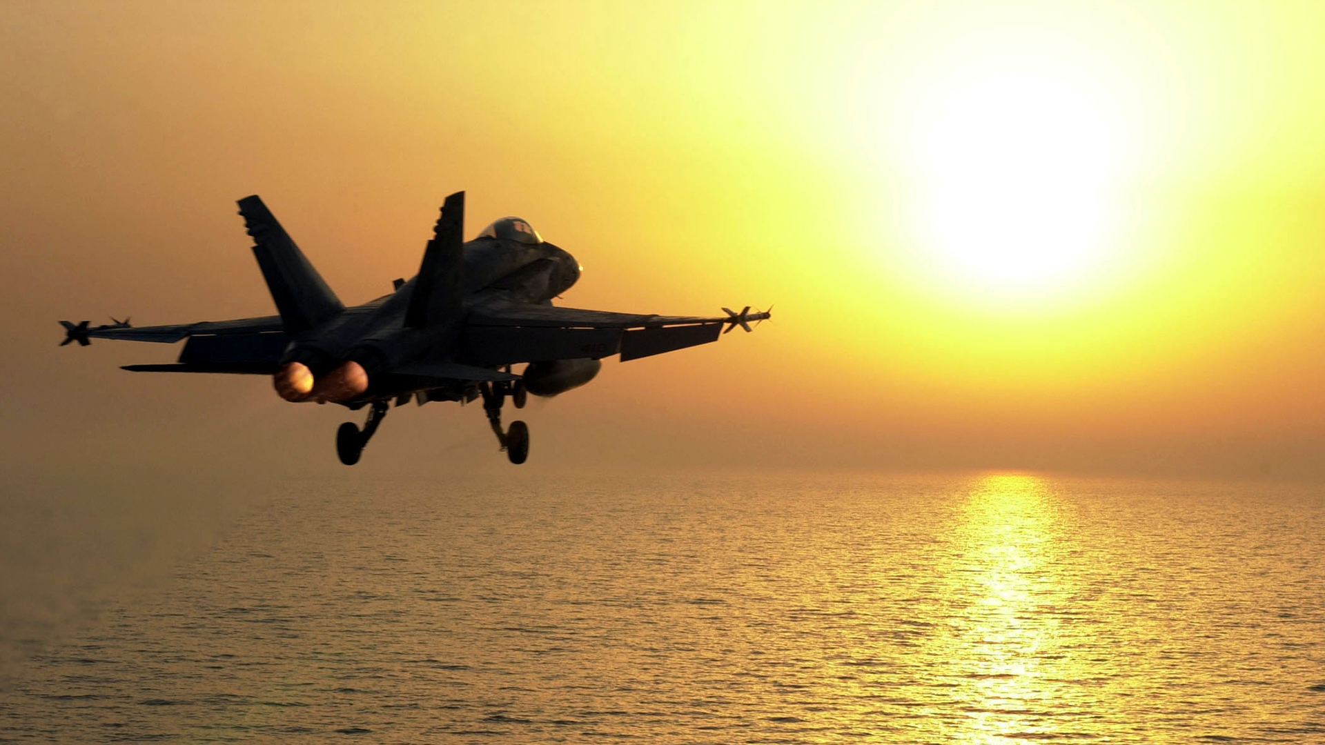 F-18 flying sunset