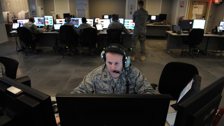 military officer looking at computer screen