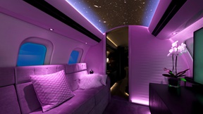 Purple lighting inside business jet cabin