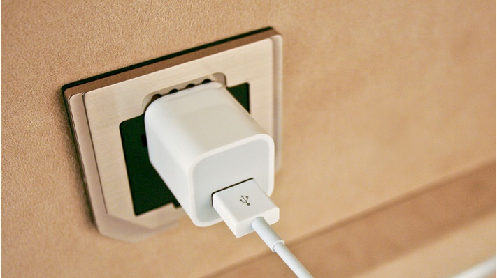 A charging cord plugged into the intelliOutlet