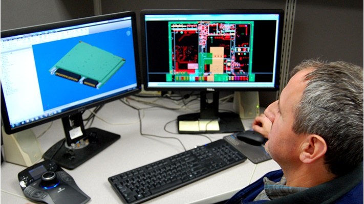 Engineer using CAD software on computer