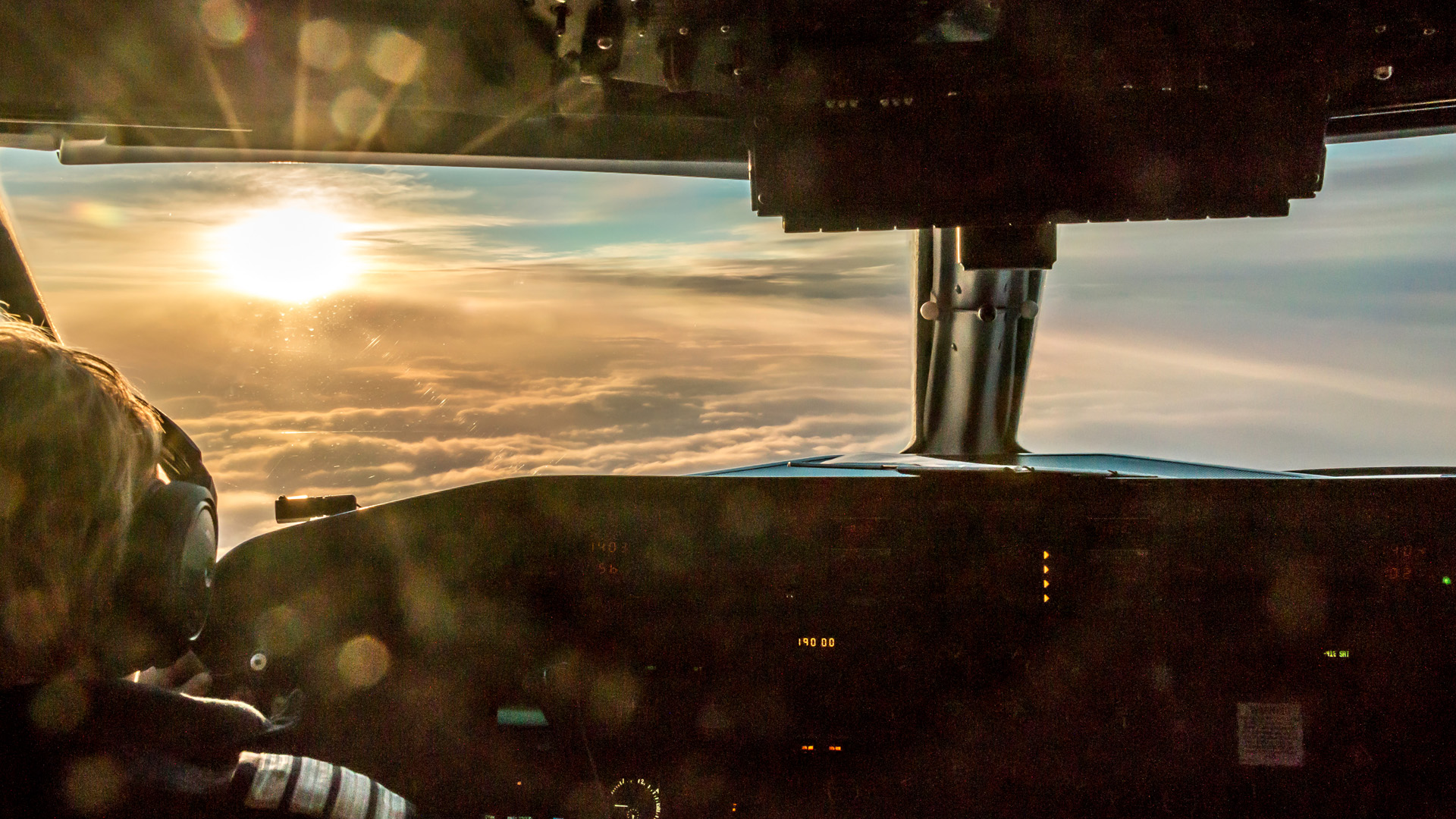 Looking out the flight deck of an airplane.