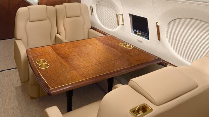 A conference table in a business jet