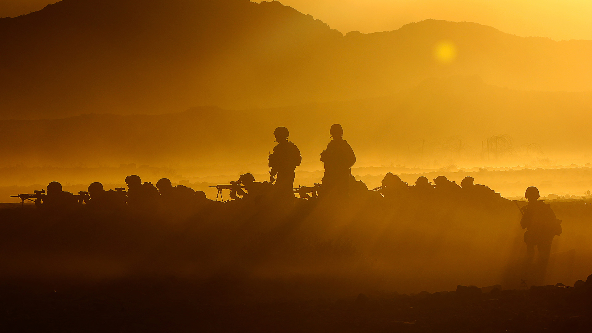 Soldiers on a sun-setting battlefield