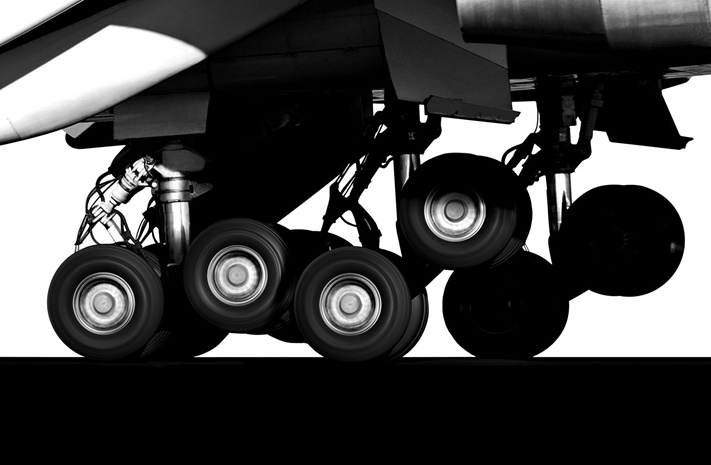black and white photo of airplane landing gear in use