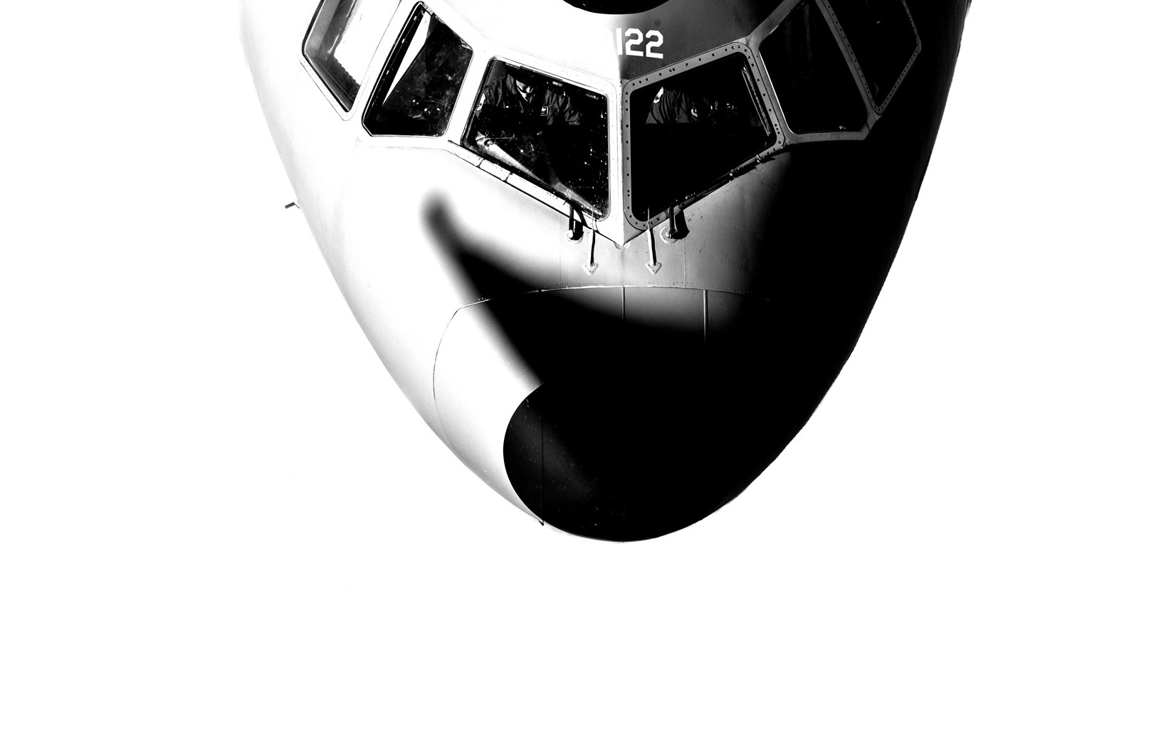 black and white aircraft from above showing into cockpit