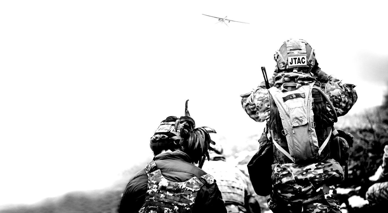 Black and white photo of two soldiers working
