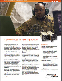 Image of service man with headset on looking at monitors