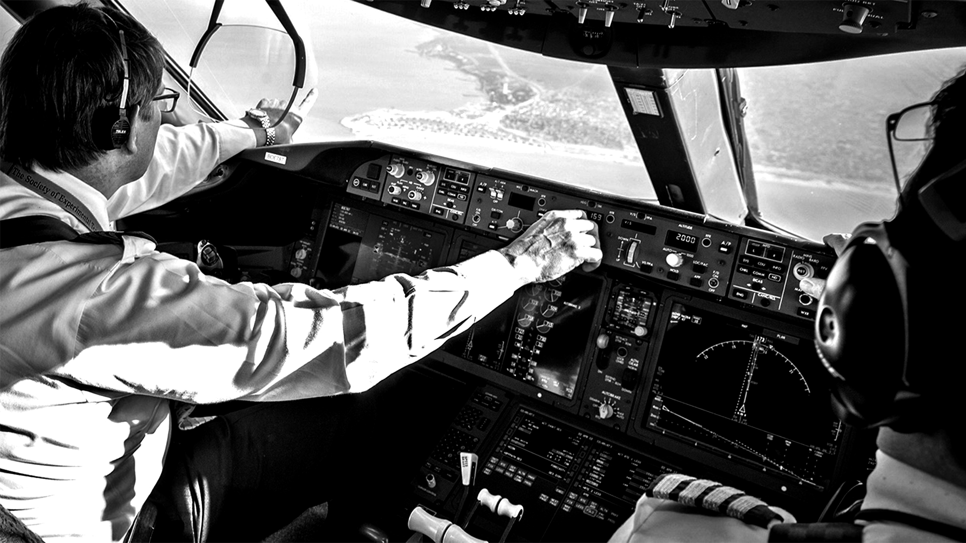 pilot pointing out to land from cockpit