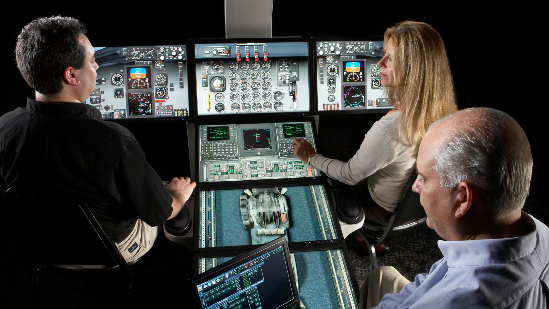 Employees learning flight deck training